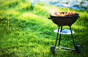 Barbecue grill with fire on nature, outdoor, close up